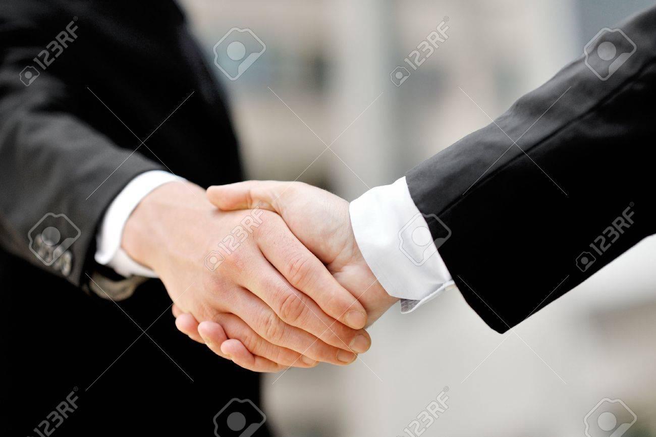 two businessmen shaking hands - business deal partnership concept - 30534183