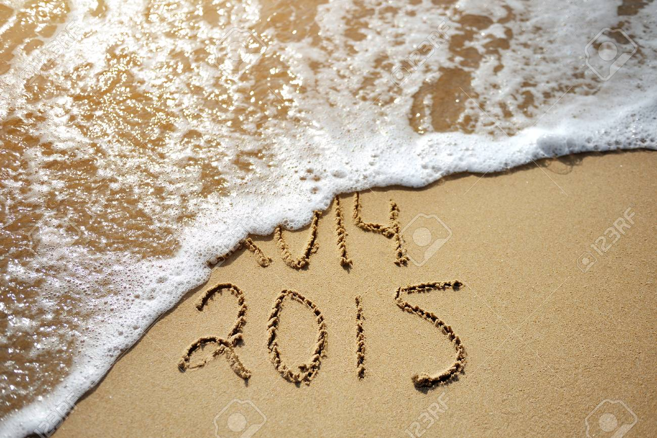 Happy Near Year concept 2015 replace 2014 on the sea beach - 34251011