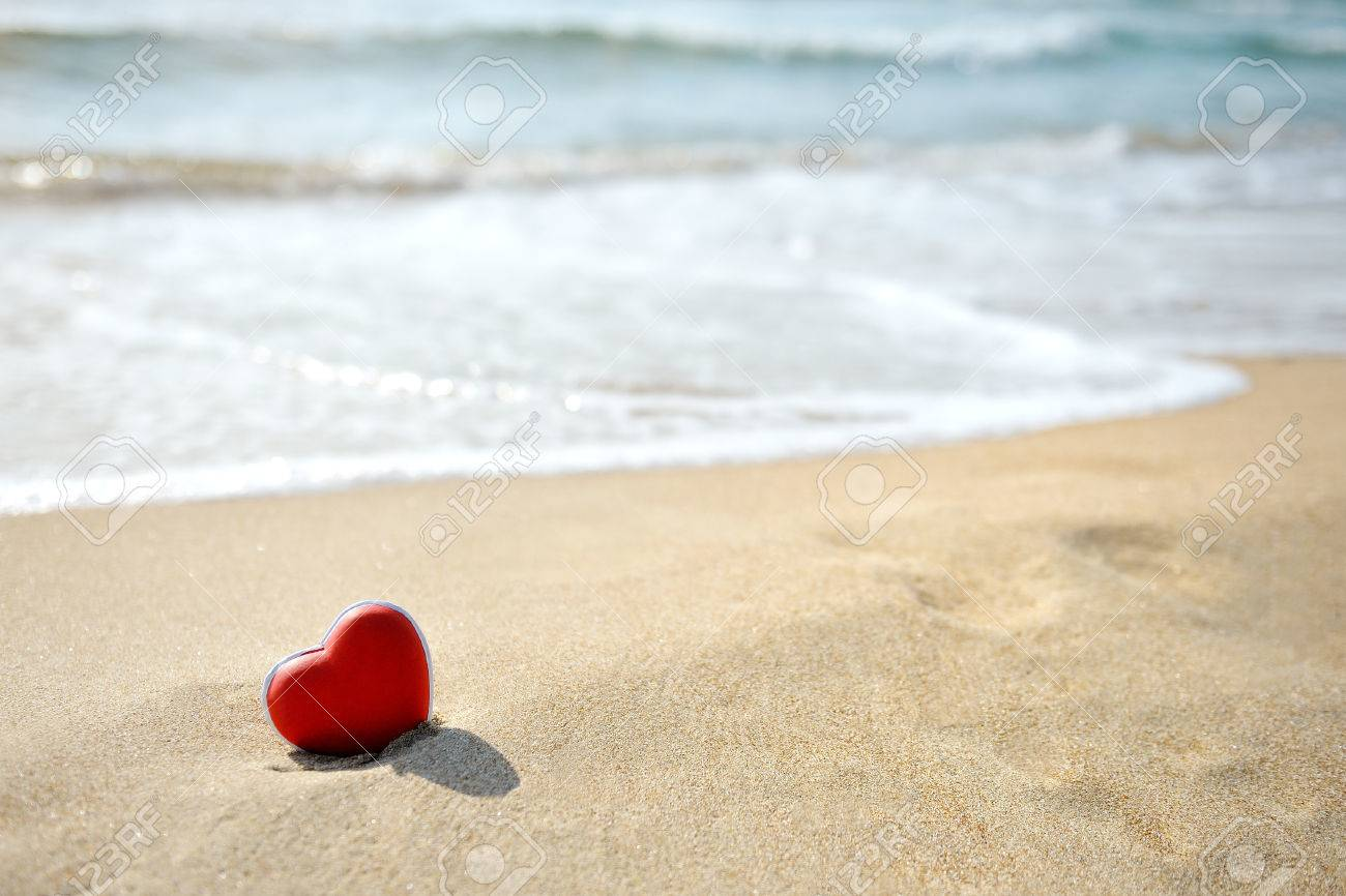 red heart on sandy sea beach - love relax concept - 34213467