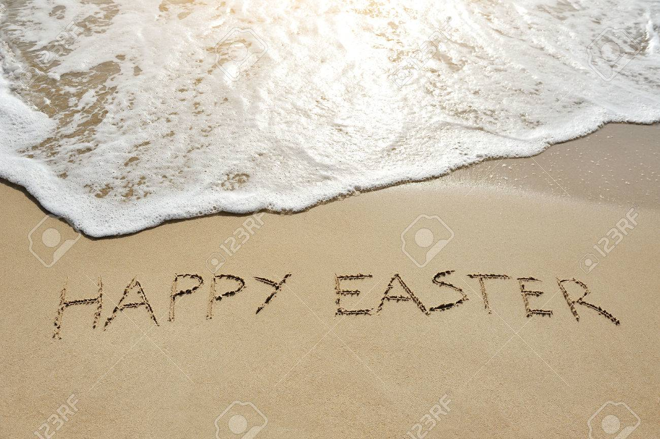 happy easter written on sand near sea - 37202348