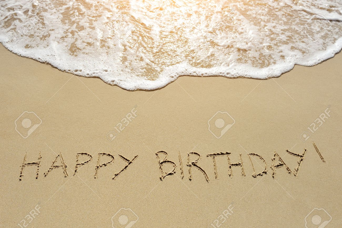 Happy Birthday Written On The Sand Beach Stock Photo