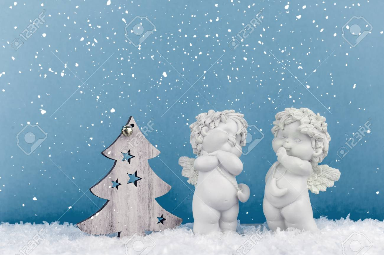Two Christmas Cherub Baby Angels Statuettes On Snow With Wooden Stock Photo Picture And Royalty Free Image Image 111829814