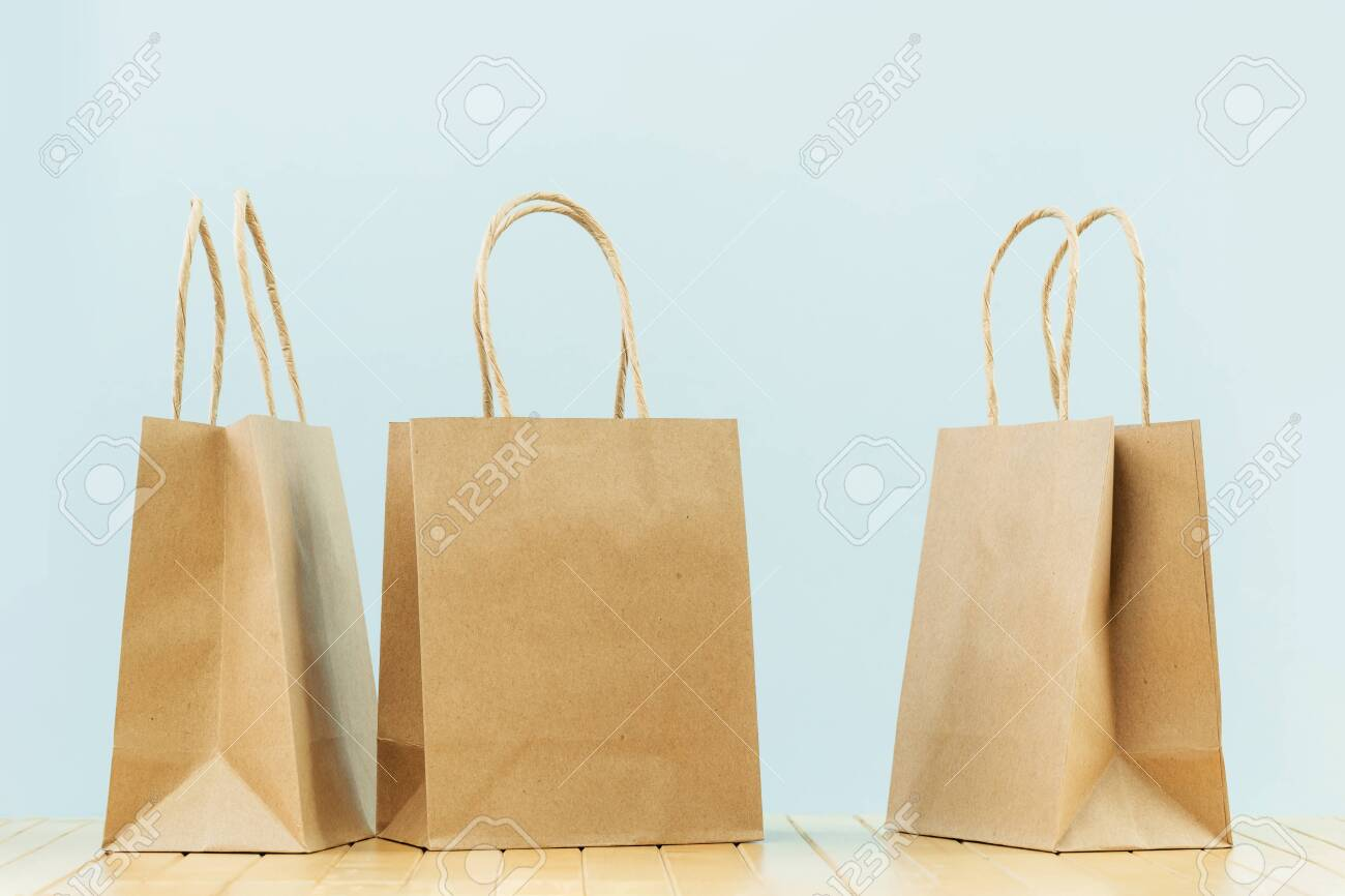 Several Buff Plain Paper Carry Bags On Grey Delivery Service Stock Photo Picture And Royalty Free Image Image 154584015
