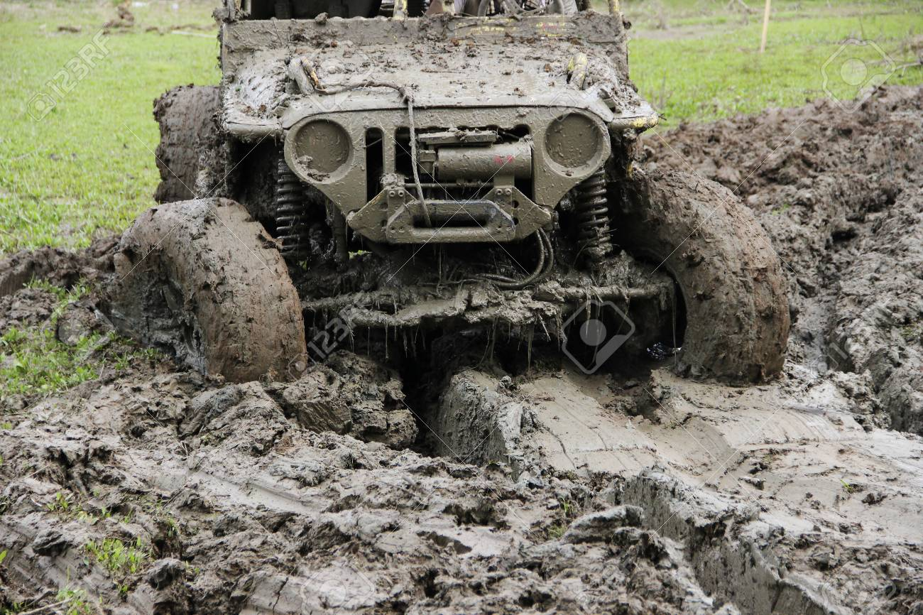 4X4 Off Road >> Muddy Off Road Vehicle Driving Through Mud On 4x4 Offroad Race Stock