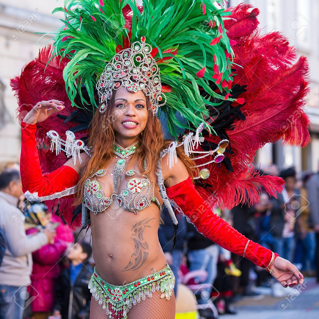 Samba dancer in traditional brazil dancing costume on the streets..