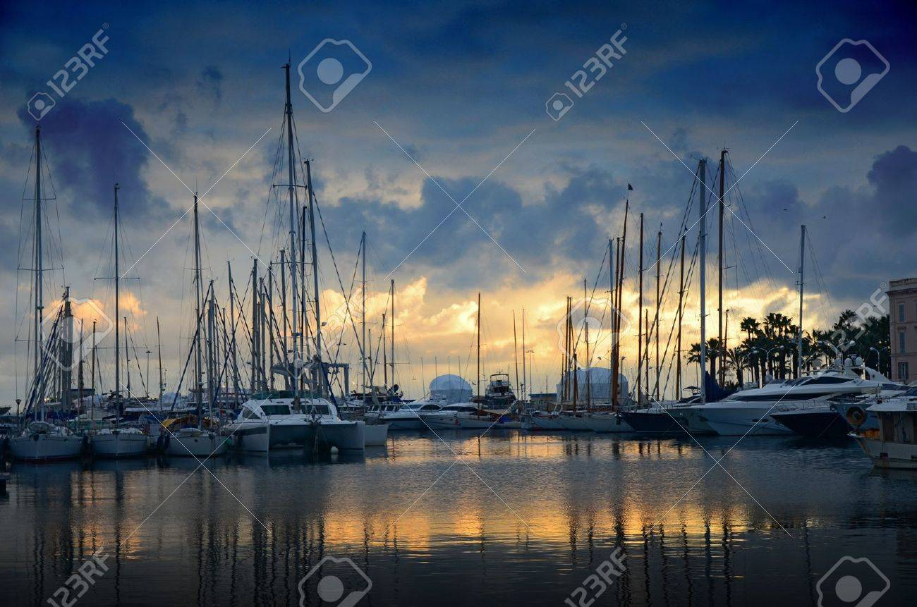 The sun set over the marina in Cannes Stock Photo - 9343124