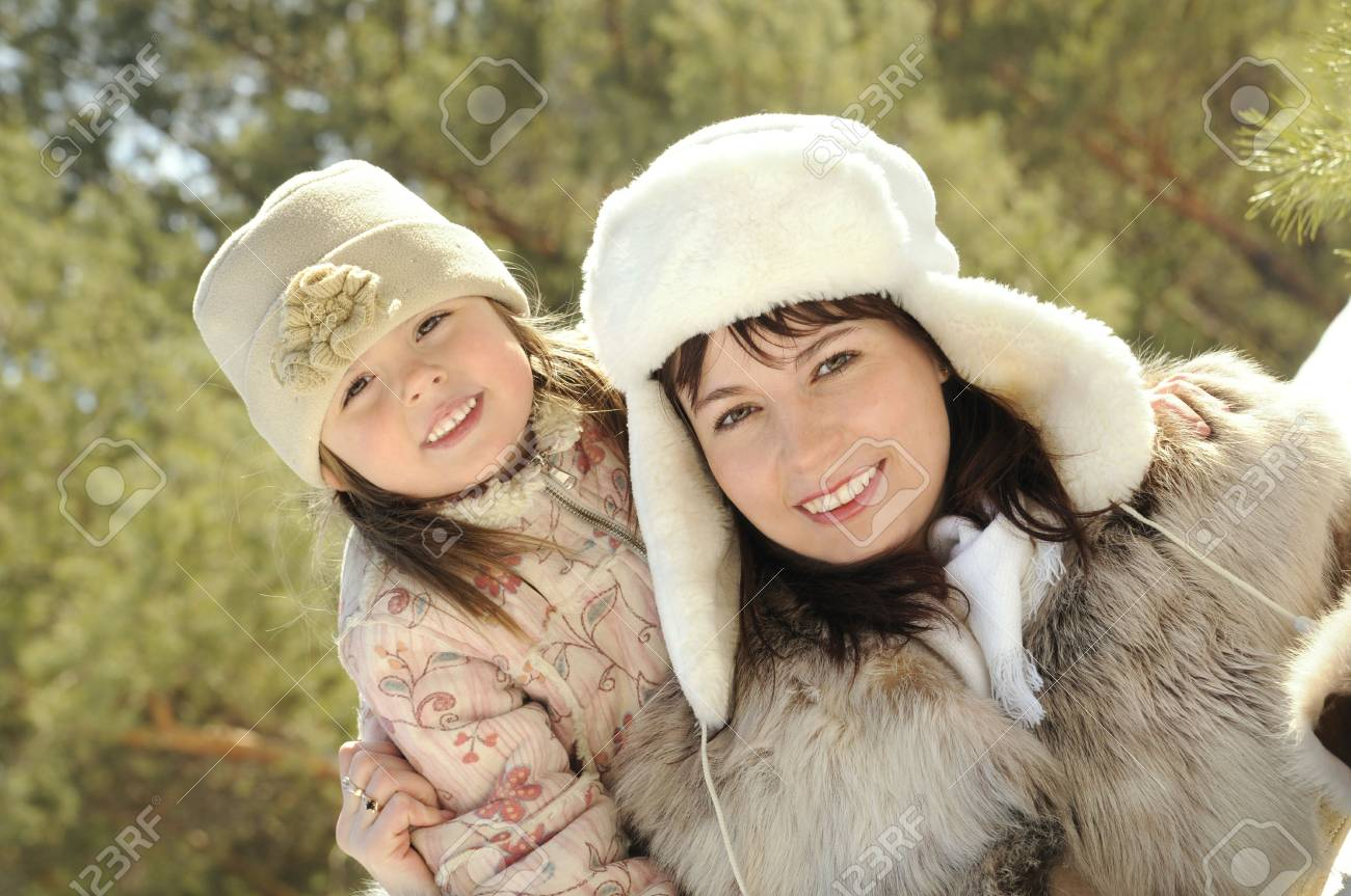 Mum together with the daughter embrace in the winter on the nature Stock Photo - 4563923