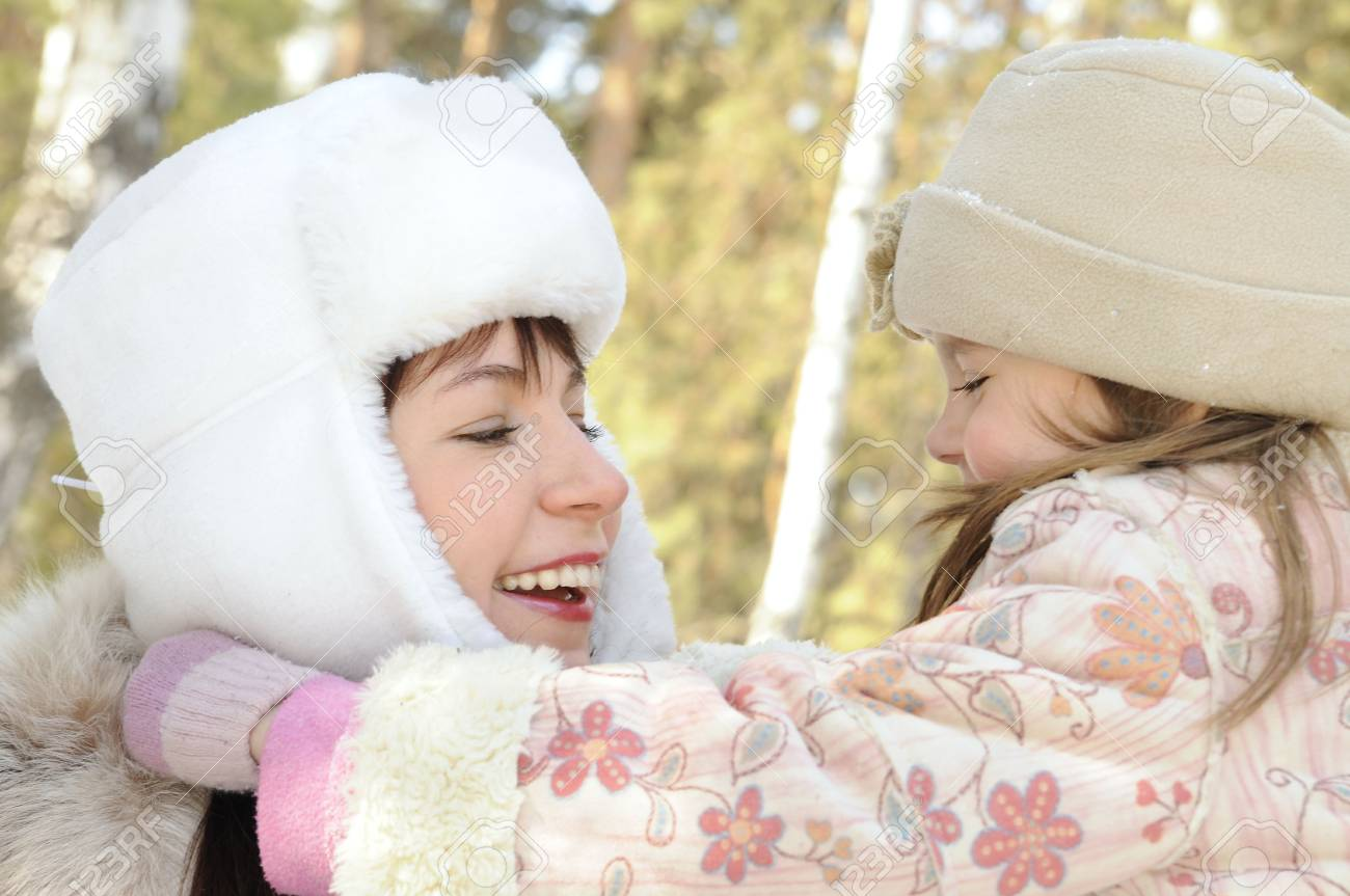 Mum together with the daughter embrace in the winter on the nature Stock Photo - 4563920