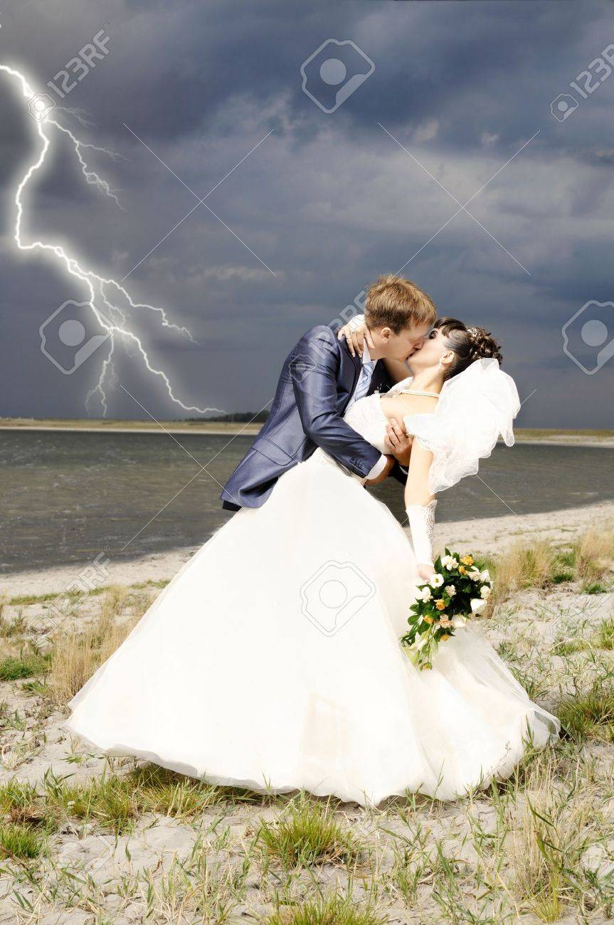 cutie happy married  couple  on nature, puff wind, hot kiss Stock Photo - 8002123