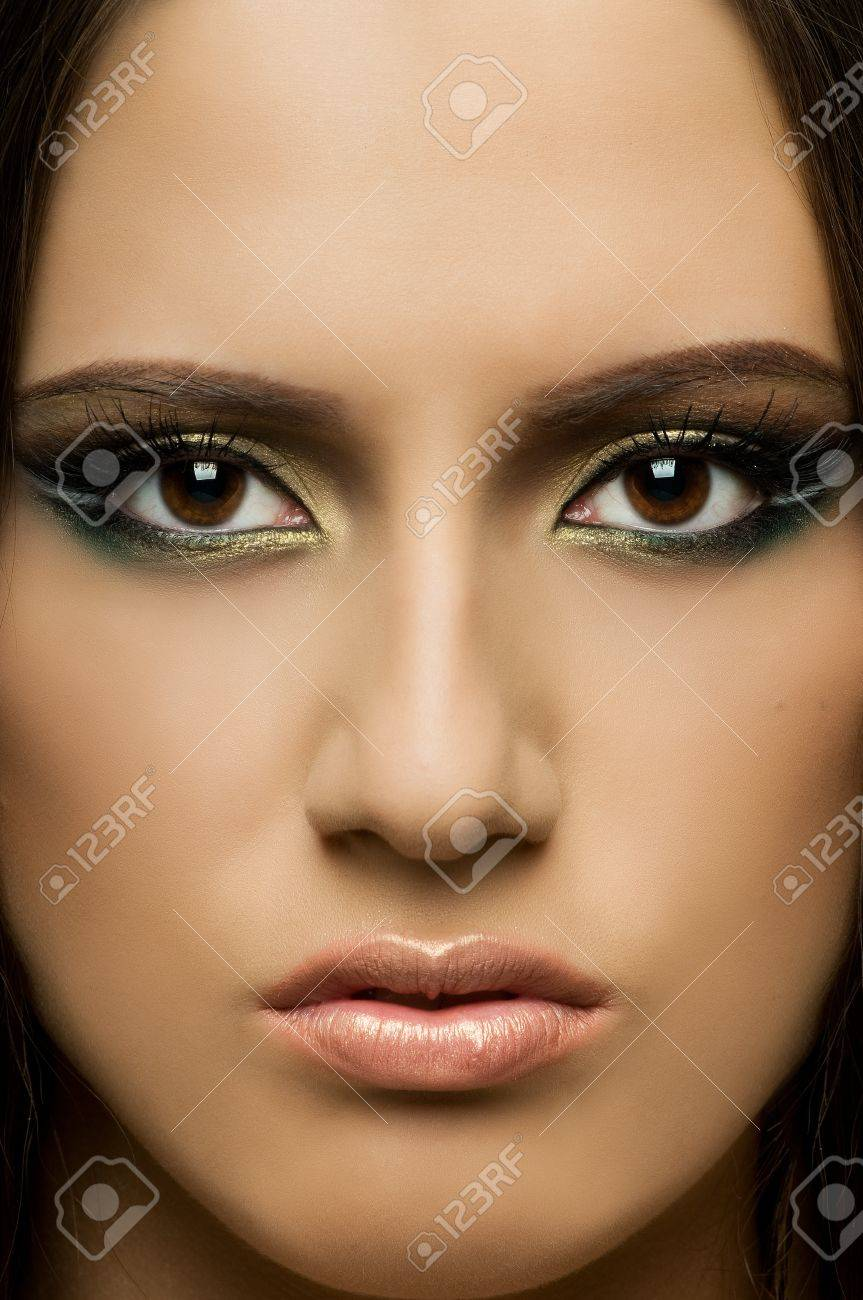 the very  pretty woman, very close fase , sensual strict  gaze... Stock Photo - 8458795