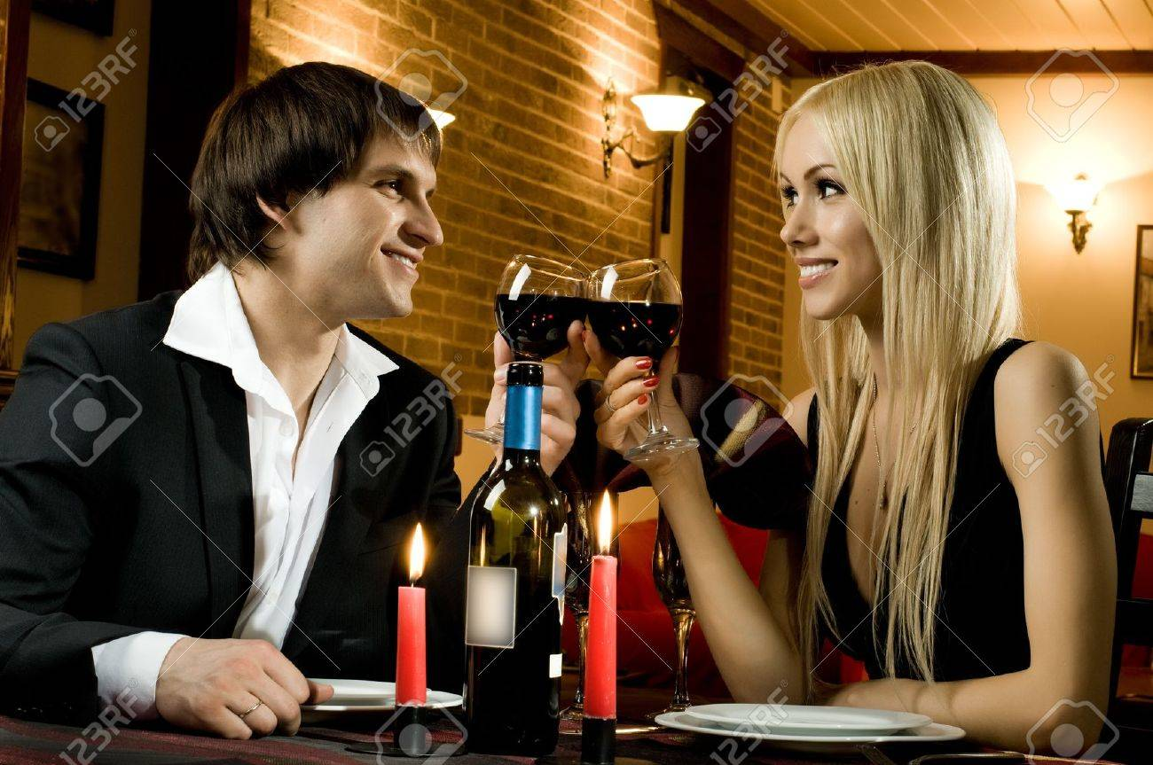romantic evening date in hotel room, or supper in restaurant, happy couple with wine glass Stock Photo - 10084713