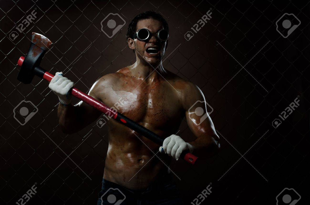 crazy frenzied chopper  butcher man covered with blood,  action with big axe Stock Photo - 11385871