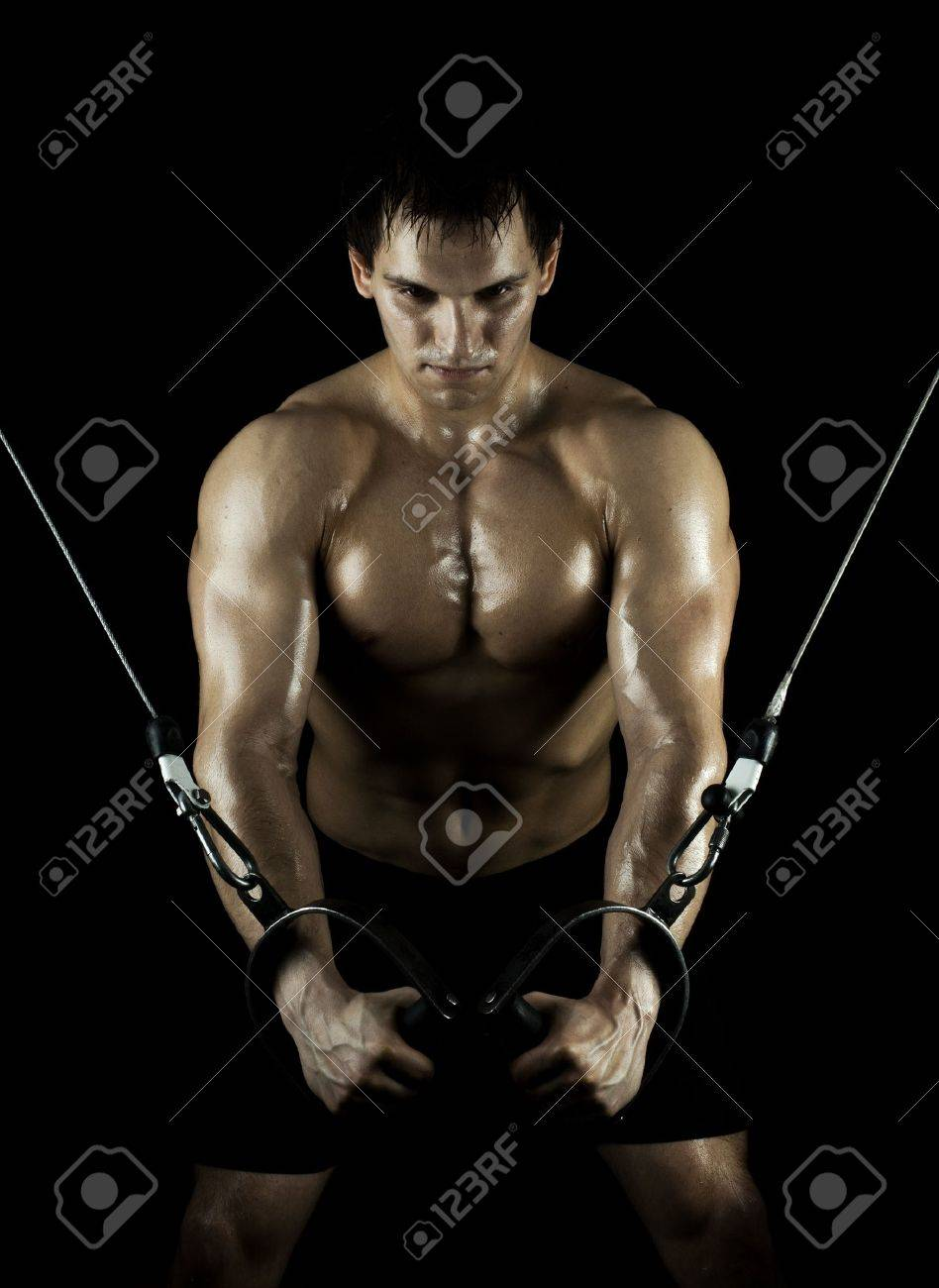 very power athletic guy ,  execute exercise on  on sport-apparatus, in  sport-hall, beauty glamour light Stock Photo - 11971764