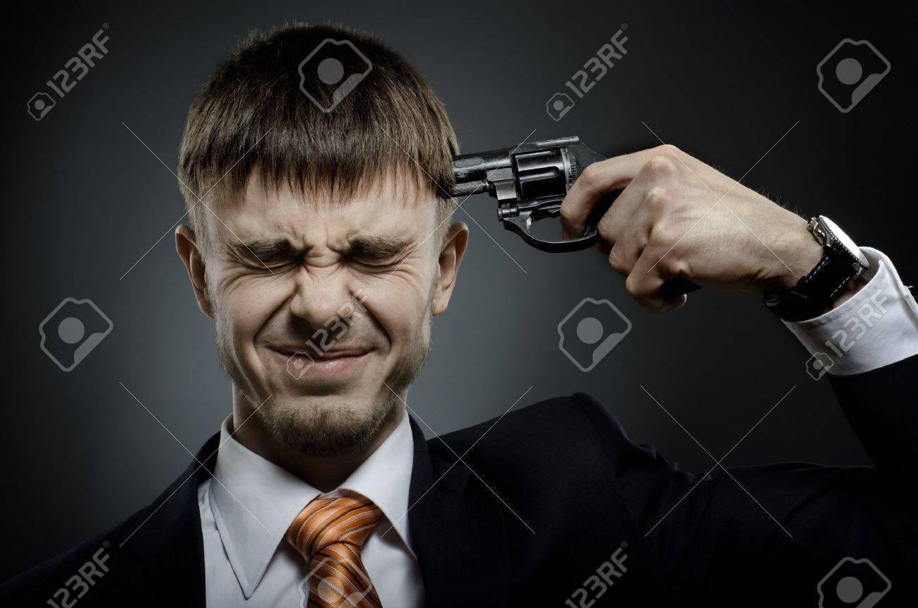 closeup portrait  the  beautiful  businessman careerist in black costume to commit suicide Stock Photo - 12008753