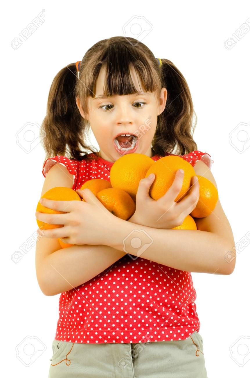 beauty little girl hold many orange and amazed, on white background, isolated Stock Photo - 13002143