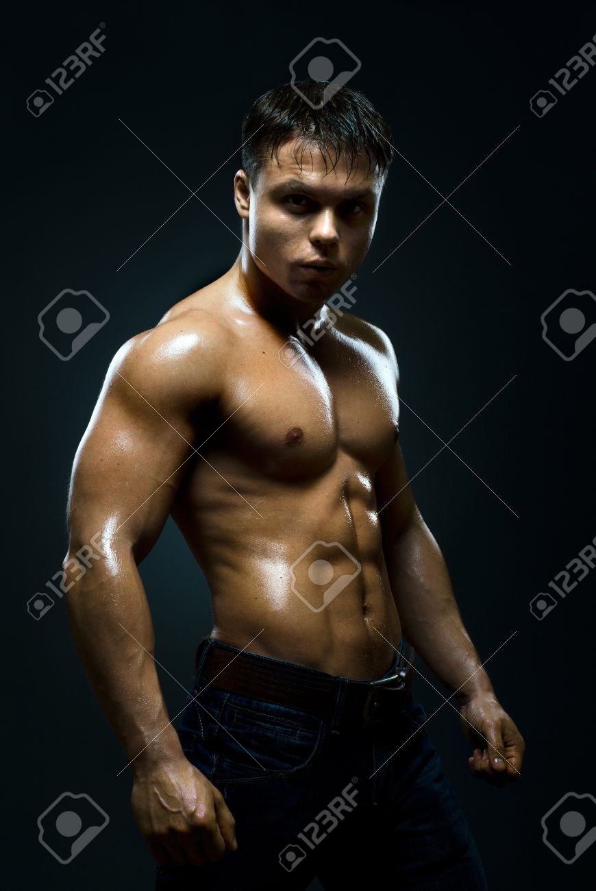 vertical photo  muscular young  guy street-fighter,  aggression look, hard light Stock Photo - 14160686