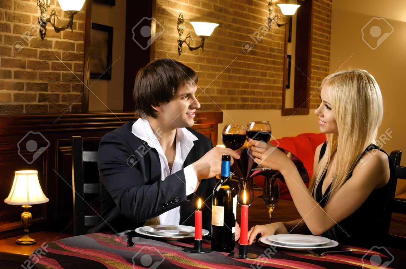 romantic evening date in hotel room, or supper in restaurant, happy couple with wine glass Stock Photo - 14571103
