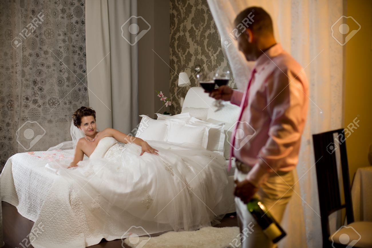 Newly Married Couple In Hotel Room Romance Wedding Night Stock Photo