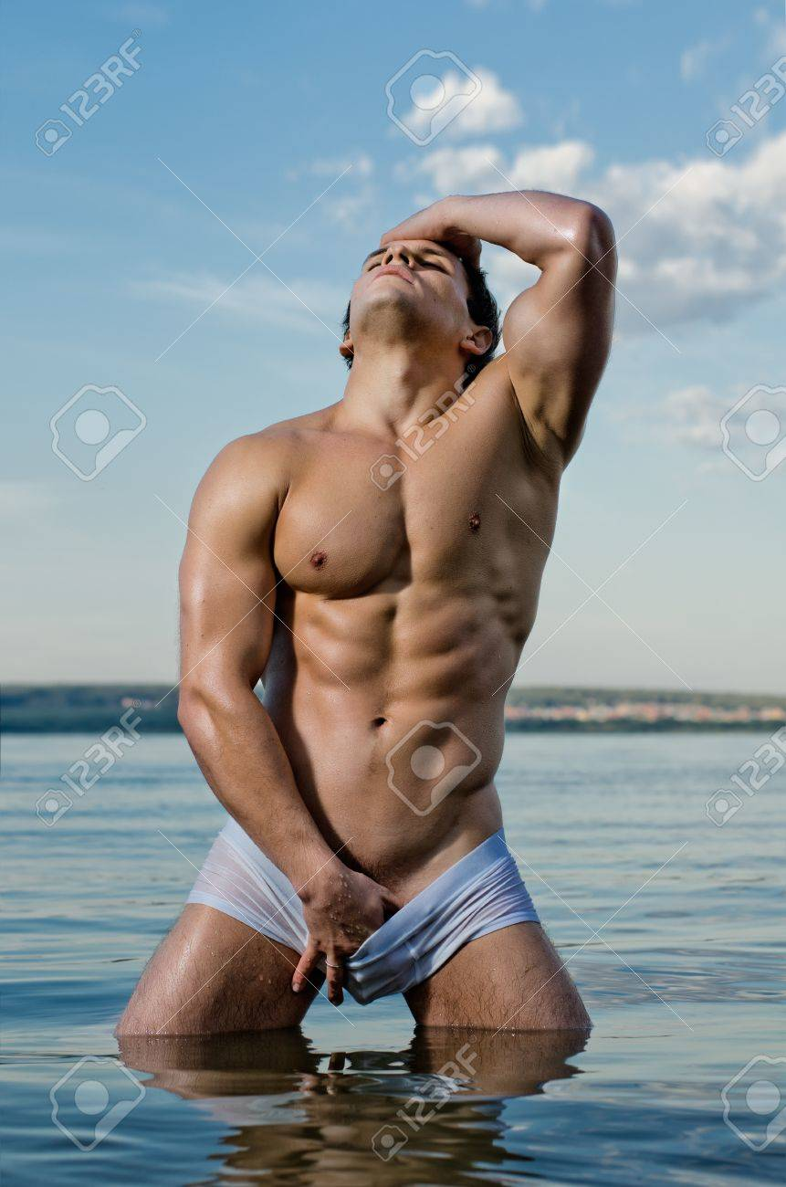 the very muscular handsome sexy guy on sky and sea background Stock Photo - 15199848