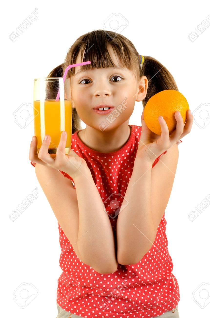 beauty little girl, holdorange and glass  juice, on white background, isolated Stock Photo - 14985060