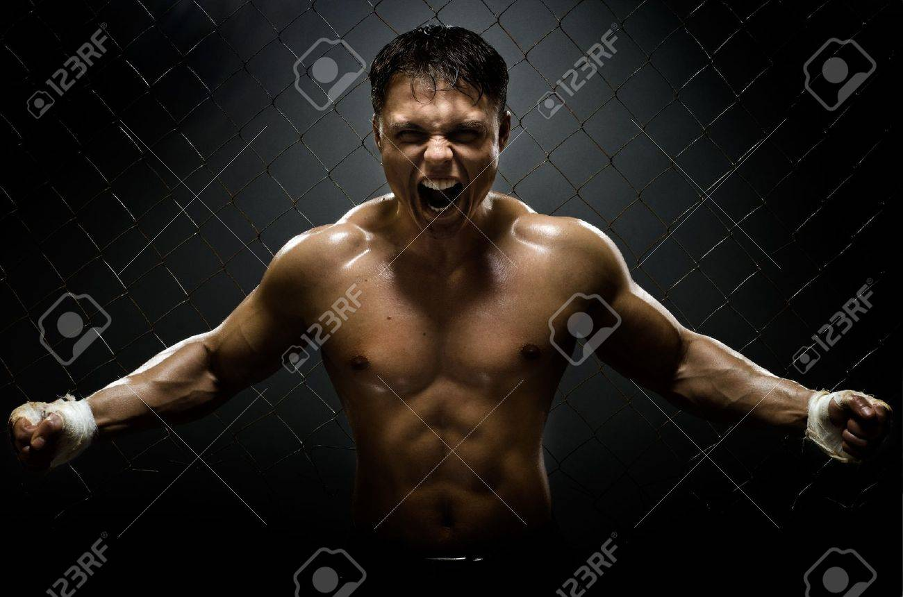 horizontal photo  muscular young  guy street-fighter,  aggression frightening  yell , hard light Stock Photo - 15497163