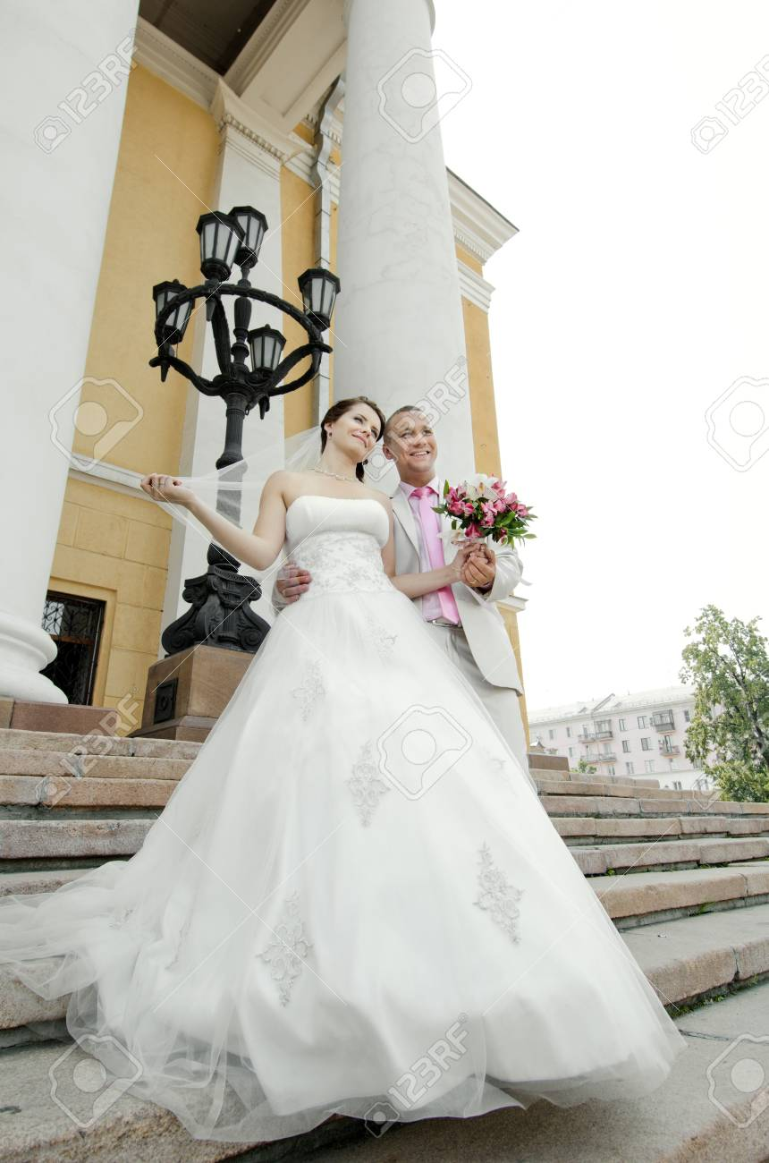 vertical portrait happy newly married couple , romance embrace outdoor Stock Photo - 15719054