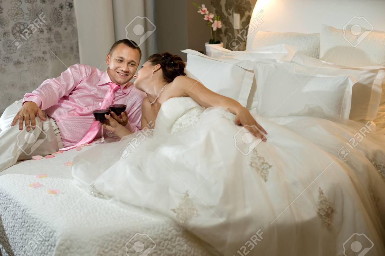newly married couple  in hotel room,  romance wedding night Stock Photo - 15807080