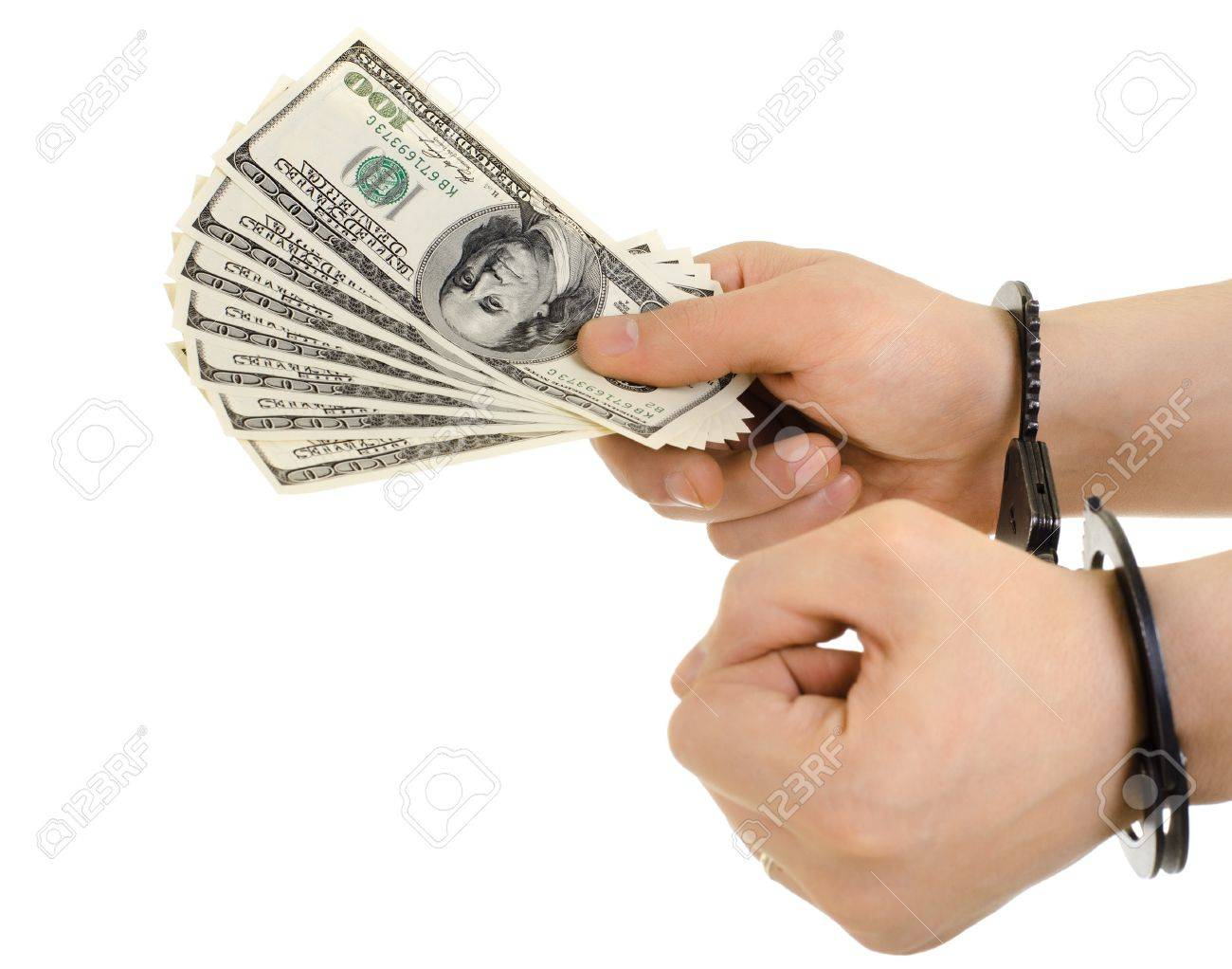 hand in shackle hold  currency note dollars, on white background, isolated Stock Photo - 16713159