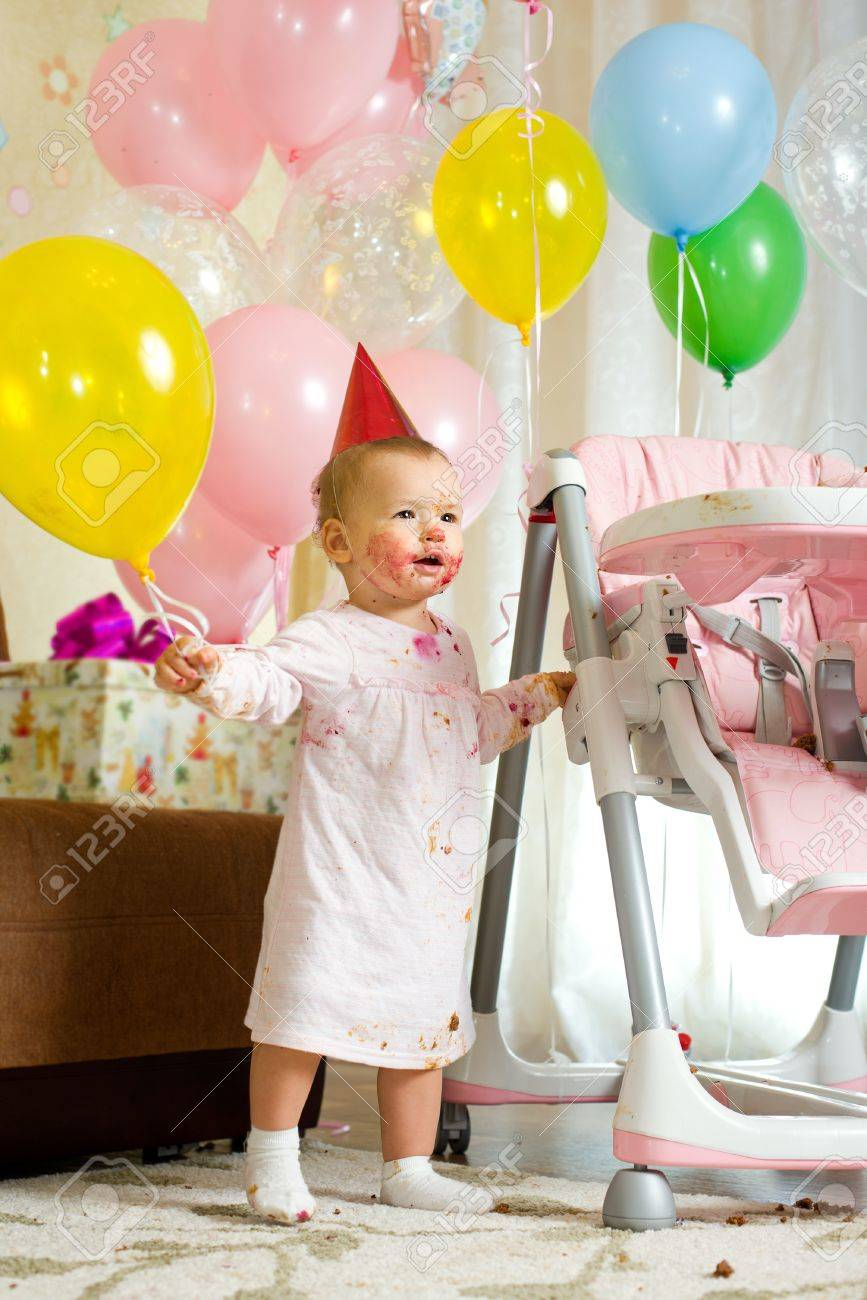 one-year-old little girl solemnize birthday with dirty-faced, stand Stock Photo - 17221363