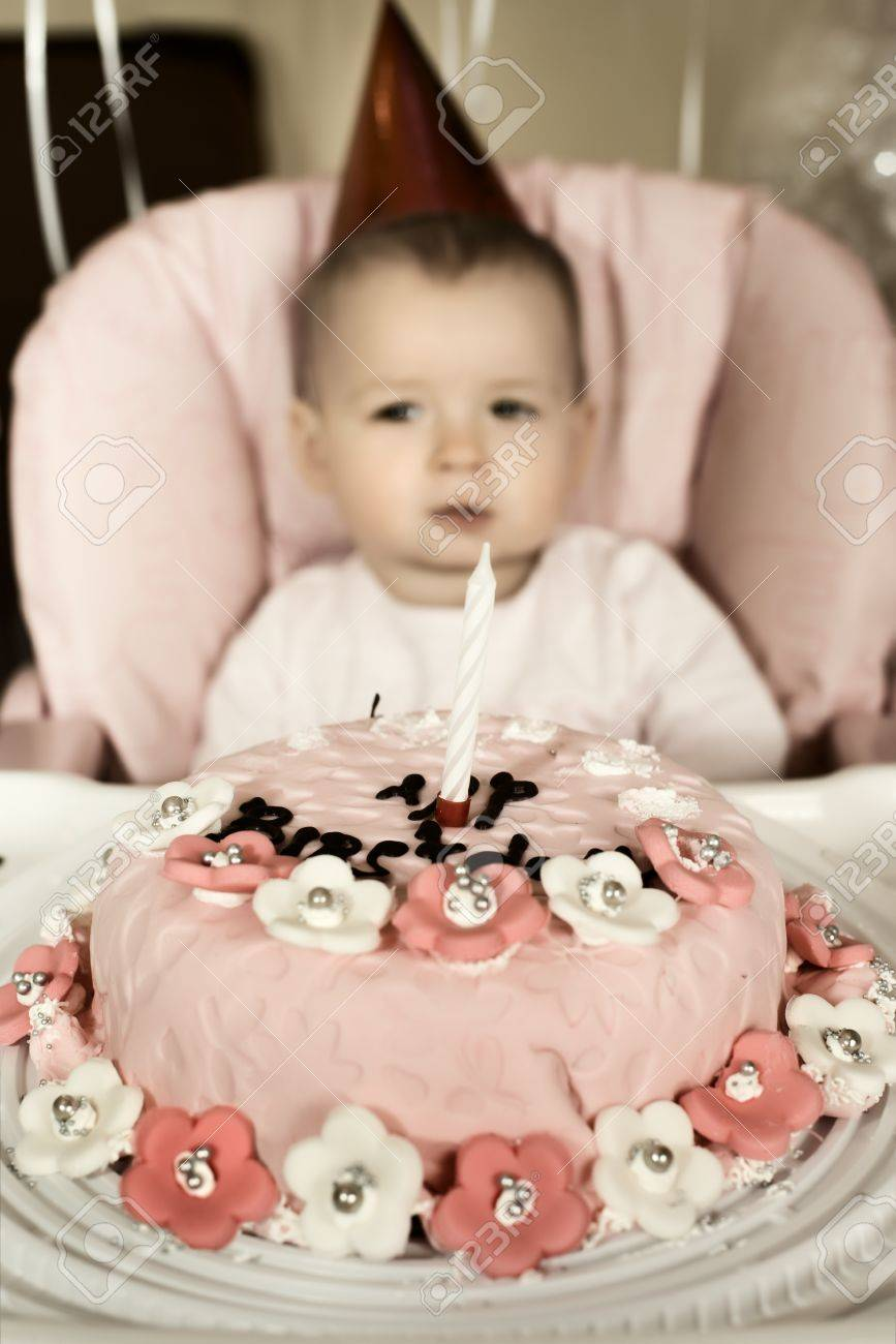 one-year-old little girl solemnize birthday,melancholy mood, vertical photo Stock Photo - 18205451