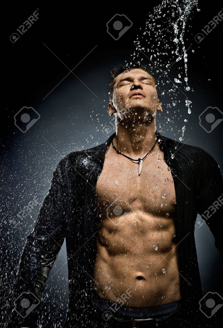 the very muscular handsome sexy guy under shower Stock Photo - 20082563