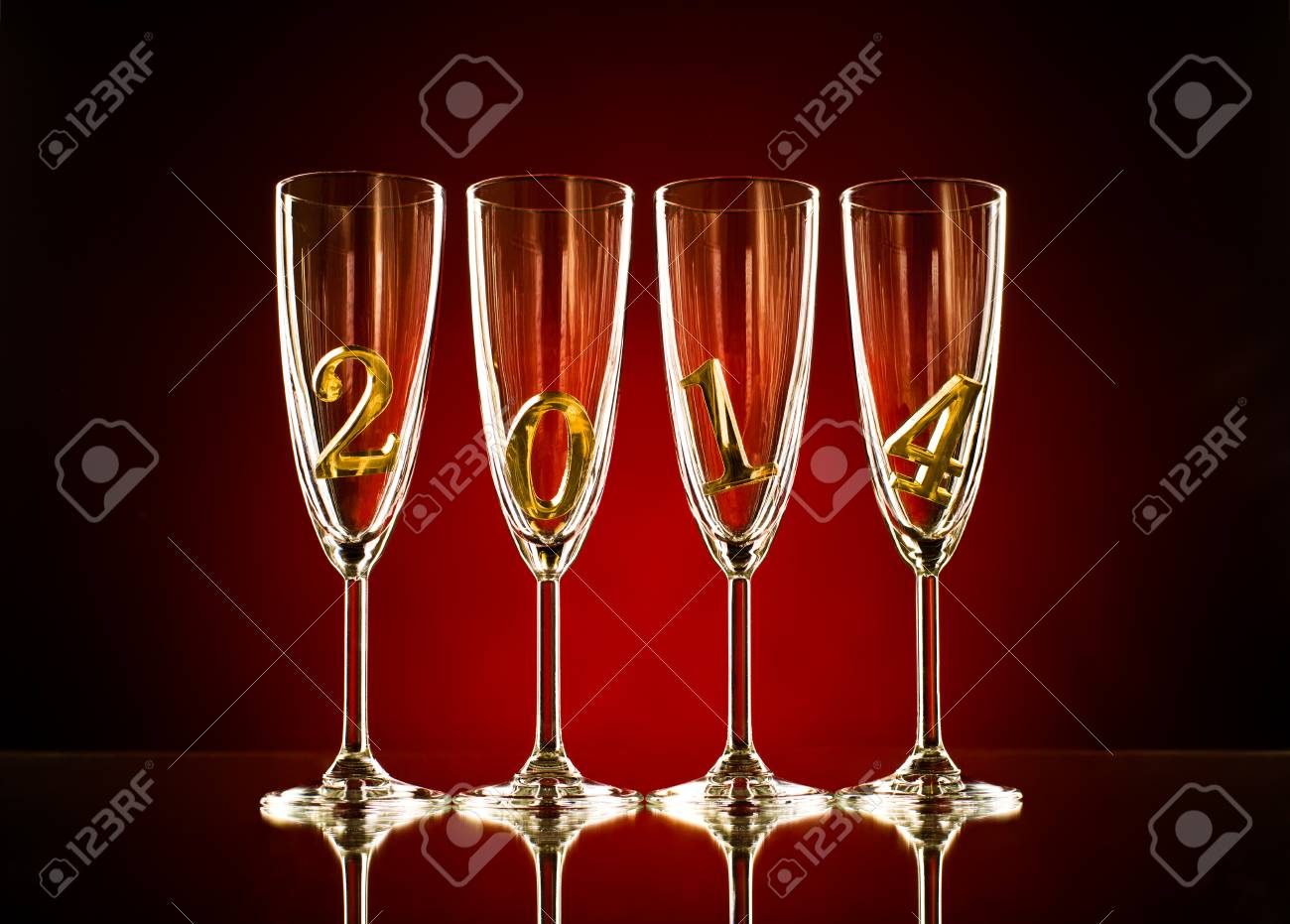 four glass goblet for champagne with  numeral 2014,  beautiful celebrations  New Year concept photo Stock Photo - 22960832
