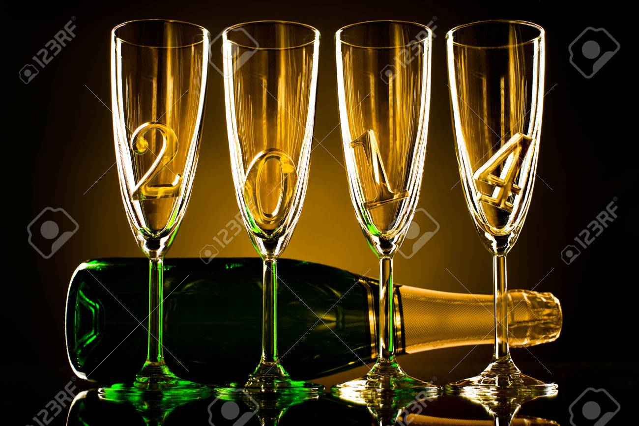 bottle  champagne with four glass goblet and  numeral 2014,  beautiful celebrations  New Year concept photo Stock Photo - 22960854