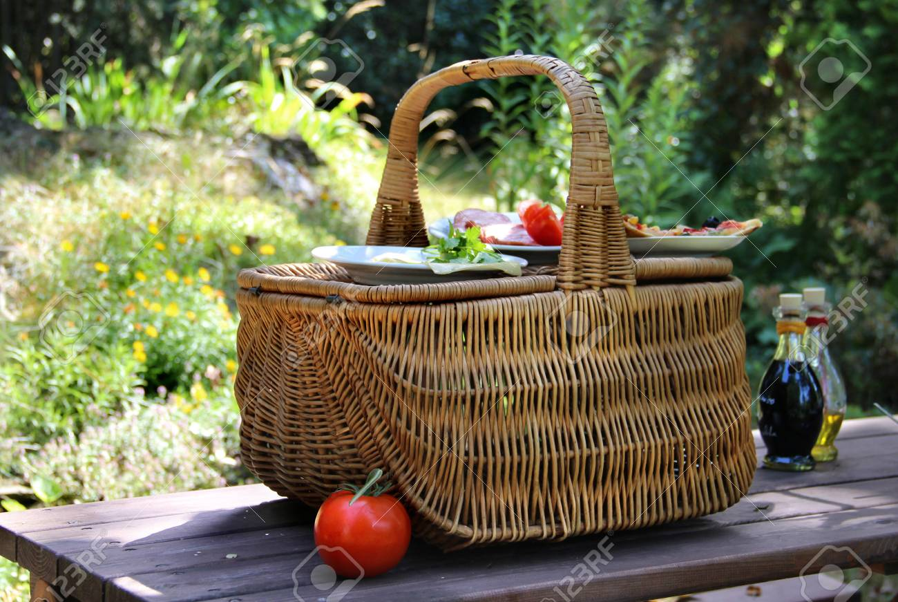 Picnic Basket On The Green Garden Background With Ham And Vegetables ...