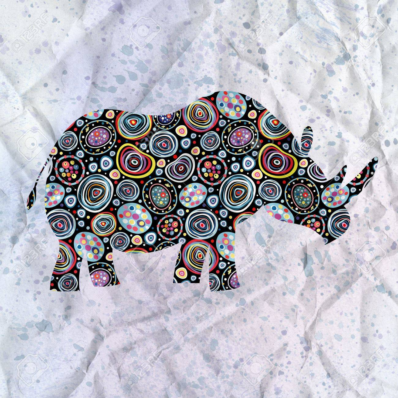beautiful ornamental silhouette of rhinoceros on the textural background Stock Photo - 19376904