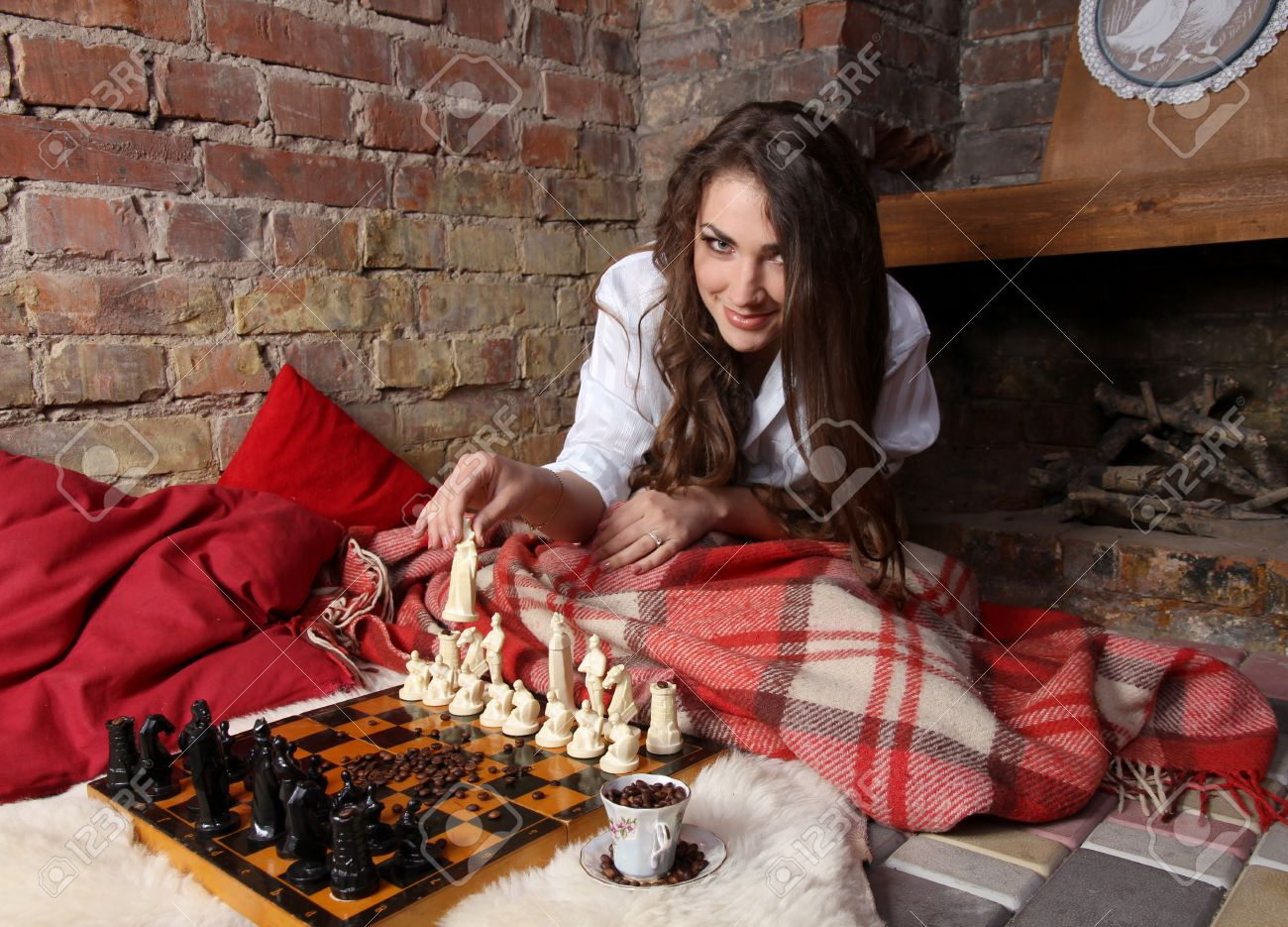 Girl Play Chess By The Fireplace Stock Photo, Picture And Royalty ...