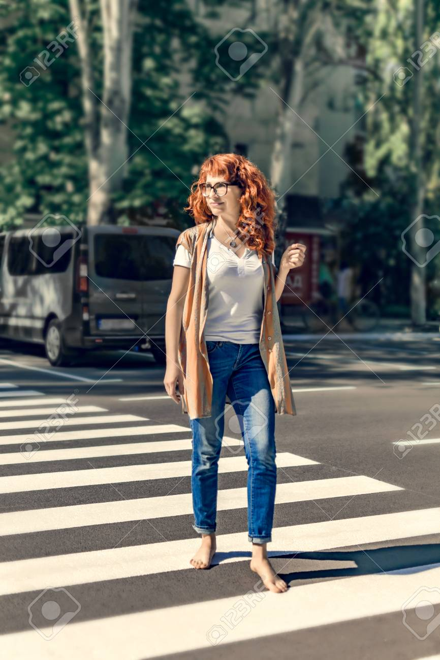 https://previews.123rf.com/images/tanya69/tanya691806/tanya69180600053/104397276-adult-happy-pretty-smiling-caucasian-redhead-dressed-in-jeans-barefoot-female-crossing-city-street-o.jpg
