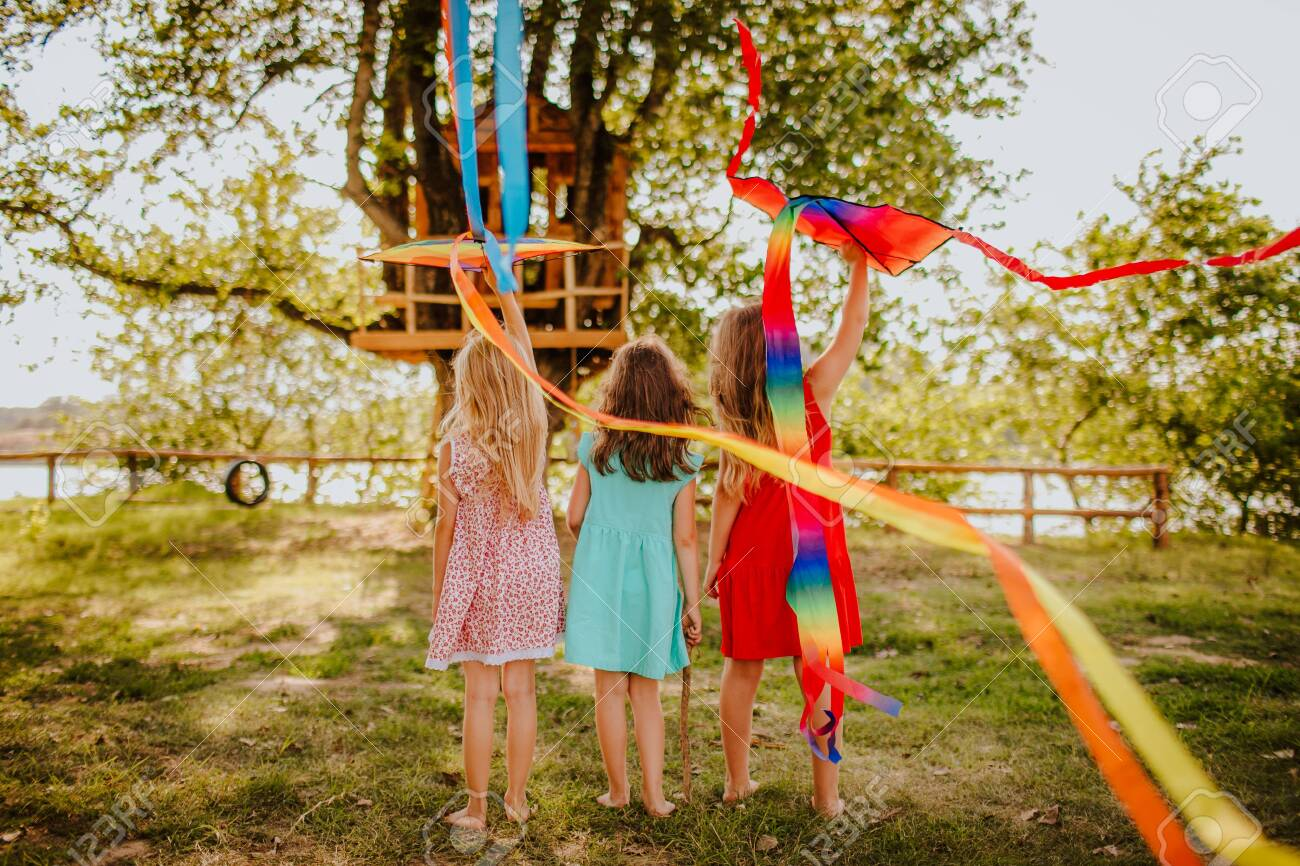 Picture of: Little Cute Barefooted Girls In Coloruful Summer Dress Playing Stock Photo Picture And Royalty Free Image Image 146817886