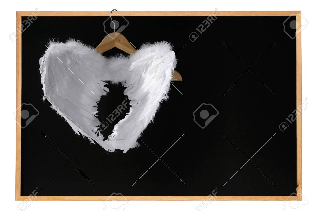 White angel wings hanged on blackboard with frame space for text white angel wings hanged on blackboard with frame space for text isolated on white stock photo jeuxipadfo Image collections