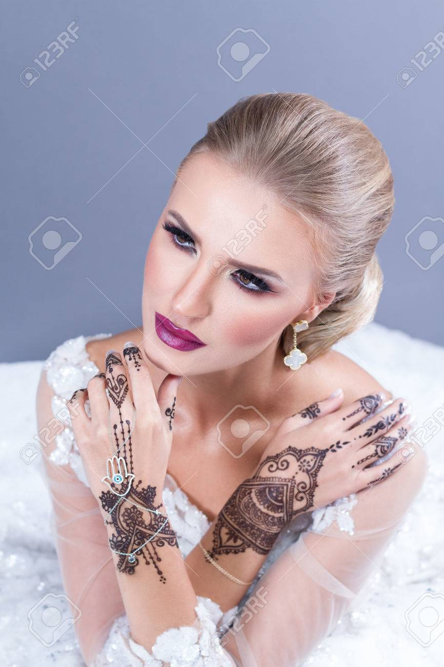 Elegant Blond Bride With Strong Make Up And Wedding Hairstyle ...