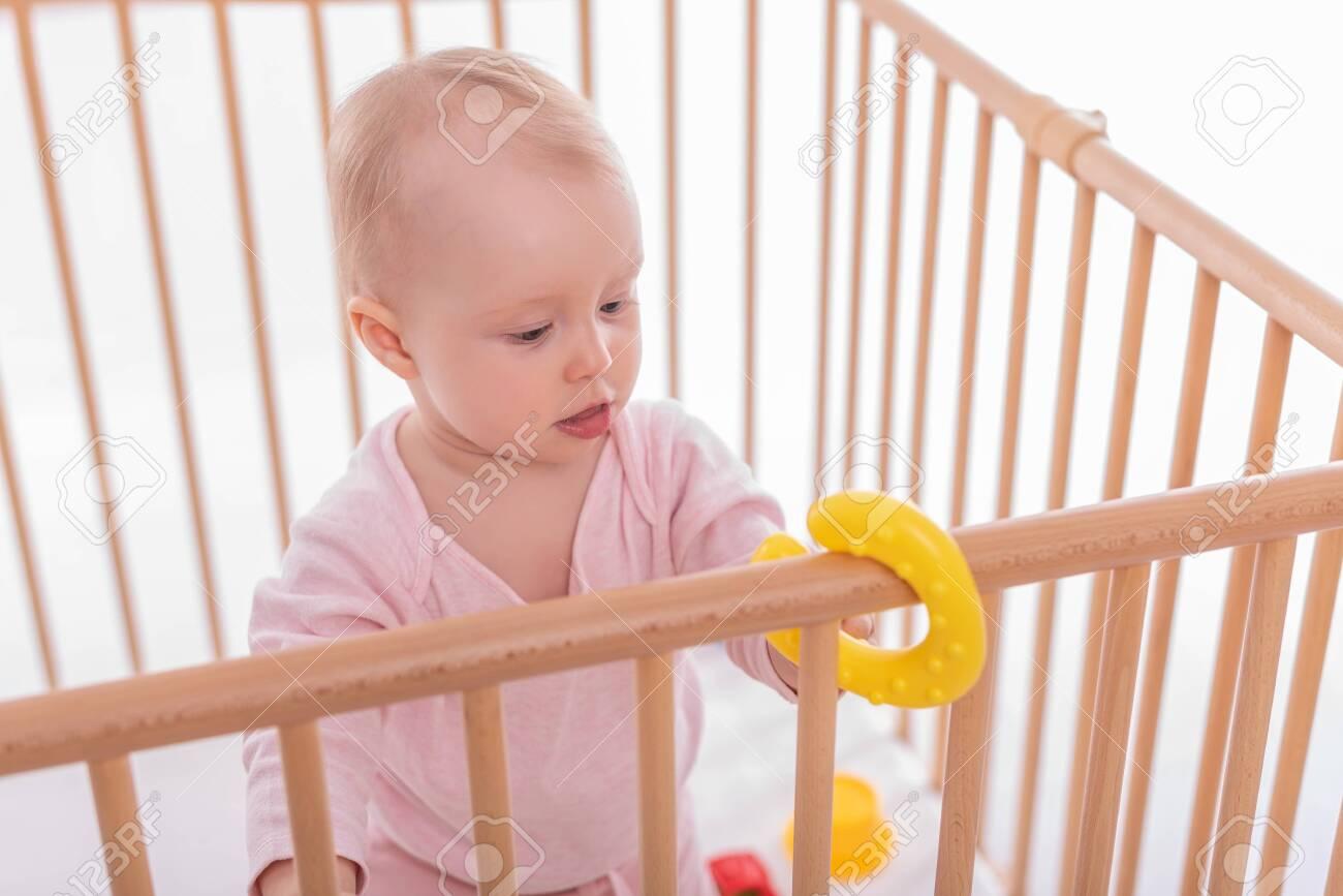 Baby girl at childrens playpen. - 135160578