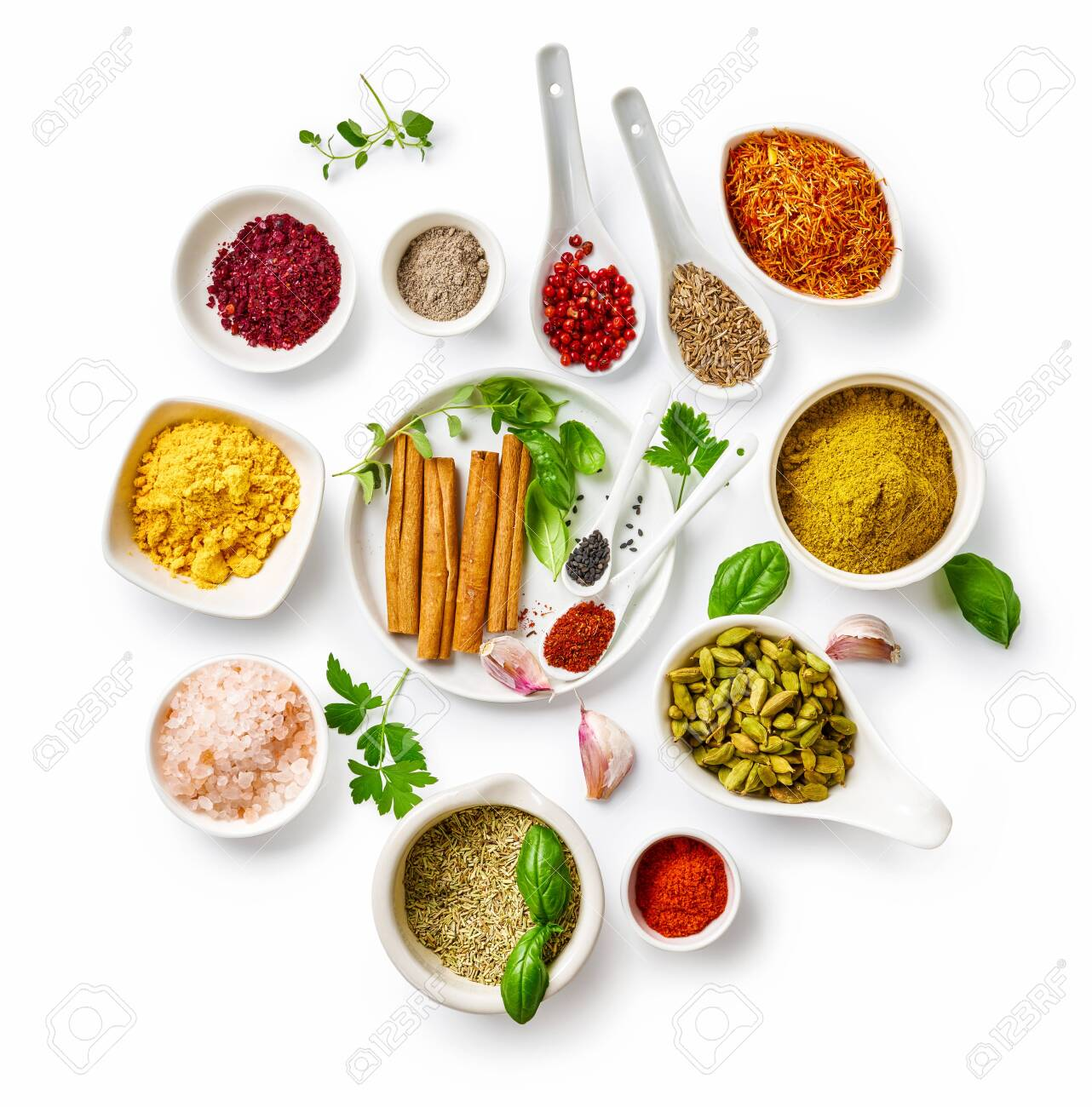 Different indian spices in a bowls and herbs on white background. Top view of indian spices with copy space. - 151395349