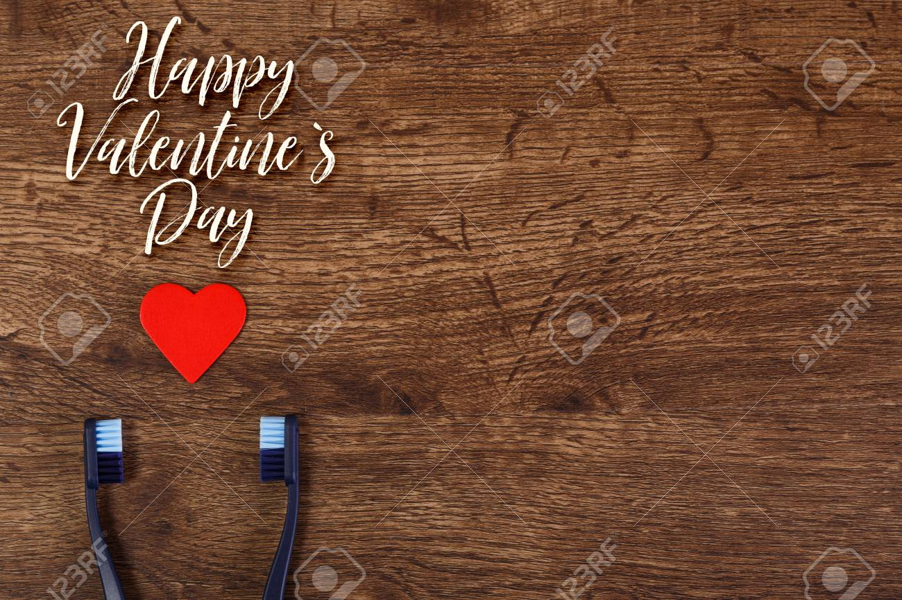 Gay Couple Love Concept With Heart And Toothbrushes Valentines Day Design On Wood Vintage Background