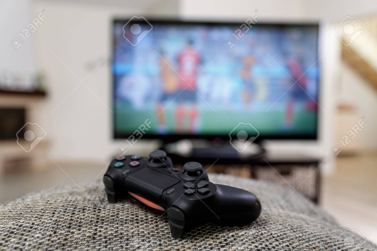 Playing Video Game Console Controller Or Joystick Football Stock