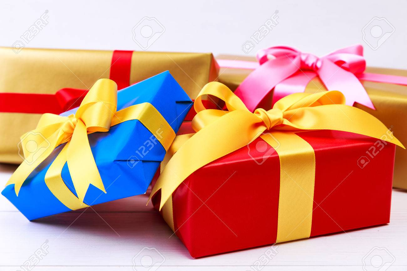 Gift boxes with bow colored presents wrapped with paper and gift boxes with bow colored presents wrapped with paper and ribbons christmas or birthday negle Images