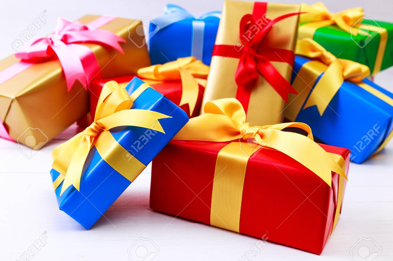 Gift Boxes With Bow Colored Presents Wrapped With Paper And