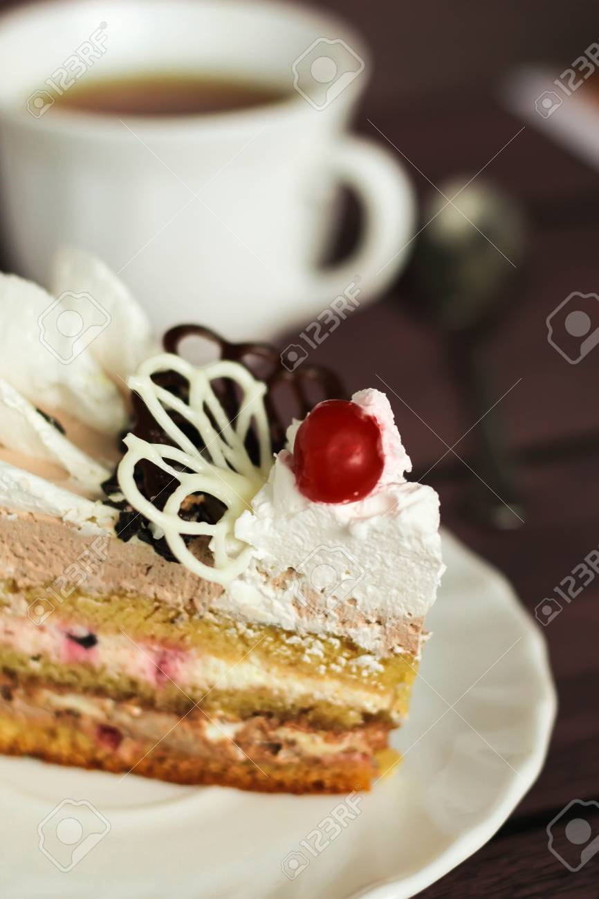 Big Slice Of Tasty Birthday Cake With Cream Cherry And Candy On The Top