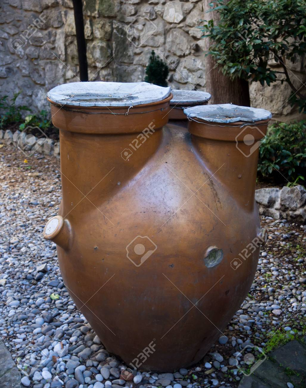 Old Clay Jug For Watering Plants In The Garden Stock Photo Picture