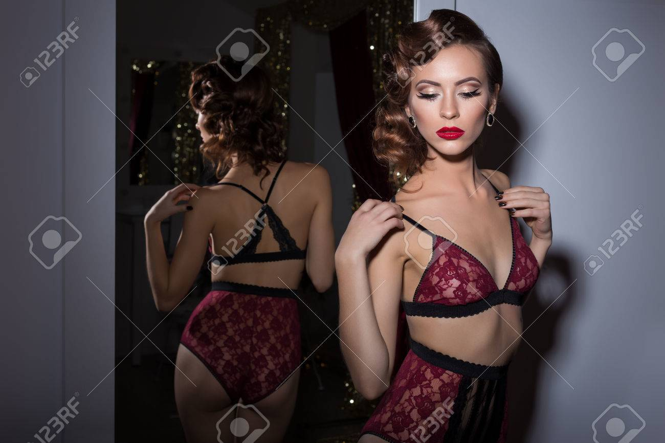 92bb3d13722 Beautiful sexy woman in lingerie delicate lace retro style 20s with elegant  evening hair and makeup