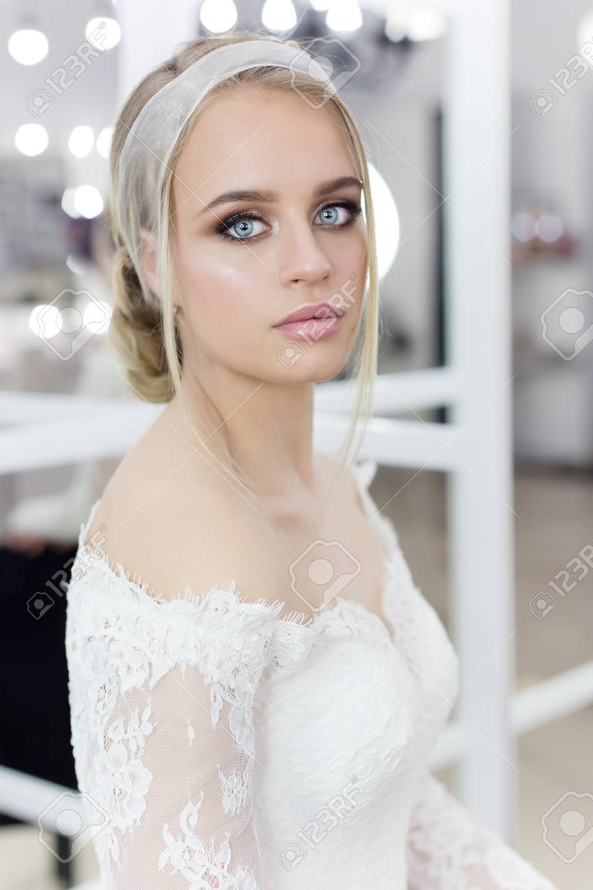 Beautiful Cute Tender Young Girl Bride In Wedding Dress In Mirrors ...